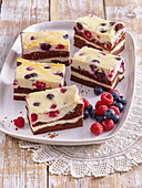 Chocolate cuts with forest berries and custard filling