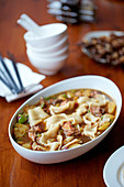 Chicken stew with chilli peppers, potato, Szechuan pepper and hand-pulled belt noodles