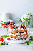 Berry puff pastry cakes with cottage cheese cream