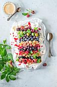 Rainbow pavlova with summer berries