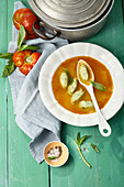 Tomato consommé with herb dumplings