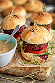 Homemade vegetarian burgers with beetroot patty and halloumi