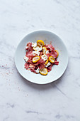 Fresh dates salade with parma ham and goat cheese