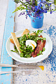Soft boiled egg, bacon and watercress salad