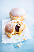 Berlin pancakes (donuts) with plum jam and powdered sugar
