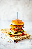 Double cheeseburger with cheddar, bacon and coleslaw
