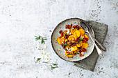 Pumpkin gnocchi with pecorino cheese, bacon and rosemary