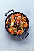 Paella with chicken, mussels and prawns