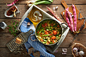 Bean soup with green asparagus and cherry tomatoes