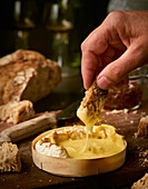 Baked camembert with bread for dipping