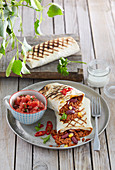 Grilled tortillas with minced meat and tomato salsa