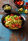 Pasta with avocado sauce and cherry tomatoes
