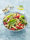 Pasta salad with spinach, strawberries and poppy seed vinaigrette