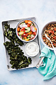 Kale chips, vegetable salad and chickpeas