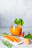 Carrot, orange and grapefruit juice with rainbow chard