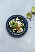 Sea bass tartare with avocado, lime and coriander