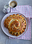 Yeast strudel with pear jam and hazelnuts
