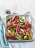 Baked sausages with Brussels sprout