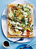 Salted ricotta tart with zucchini and black garlic