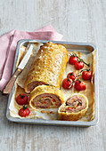 Minced meat roll in puff pastry