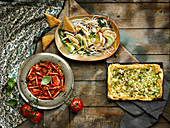 Asian poached chicken, courgette feta and olive filo tart, tomato salad