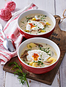 Dill soup with poached eggs