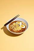 Ramen with Soft Boiled Egg and Chopsticks