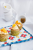 Matcha cupcakes with mango topping
