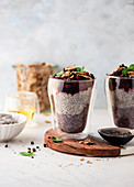 Chia pudding with berries, wholemeal cornflakes and cocoa nibs