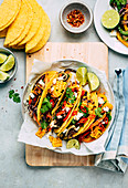Colourful tacos with vegetables, chilli and lime
