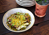 Bhel pourri - snacks made from puffed rice, vegetables and tamarind sauce