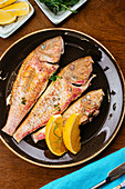 Grilled fish with herbs and lemon