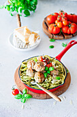 Pasta with pesto and meatballs