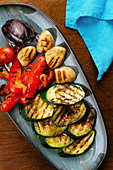 Grilled vegetables onion, tomato and zucchini
