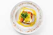 Toast with poached egg, salmon and mustard sauce