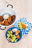 Herbal croquettes with dip and salad