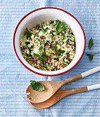 Couscous salad with tomato, cucumber and parsley