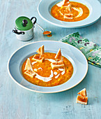 Carrot soup with toast boats