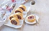 Biscuit roll with cardamom and blueberry jam