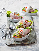 Ham rolls with potato and sausage salad and boiled egg