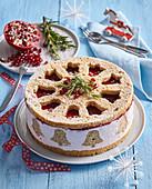 Granatapfel-Weihnachtstorte mit Glockenmotiven