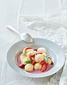 Custard dumplings with strawberry sauce