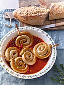 Roast sausage spirals in chilli sauce