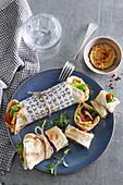 Pita bread rolls with hummus