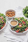 Salad with roasted chicpeas, tomatoes, kale and mustard vinaigrette sauce