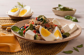 Quinoa salad with chickpeas, peppers, eggs and feta cheese