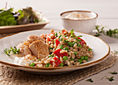 Chicken breast with a barley and vegetables salad and yoghurt sauce