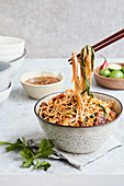 Tempeh soba bowl with a sesame seed and lime sauce