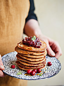 Oat and apple pancakes with cranberry sauce