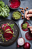 Stuffed beetroot ravioli with kale and hazelnut pesto being made